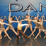 Dance team in gold